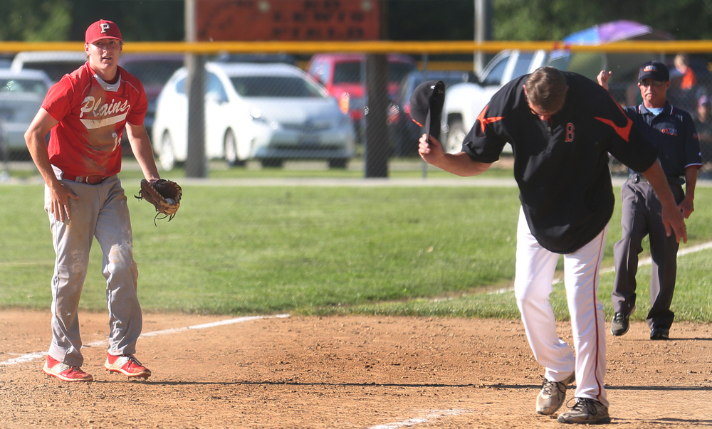 Beardstown first base coach Brian Dour almost threw his hat down in disgust but held onto it after Plains first baseman Dylan Bee at left caught a line drive made by Tigers batter Will Robertson to end the sixth inning with men on base. David Spencer/The State Journal-Register
