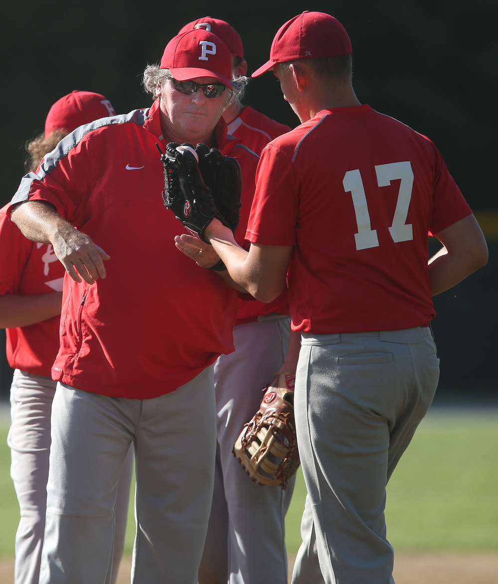 Plains head coach Dave Coach gives the ball to relief pitcher Alex Edwards. David Spencer/The State Journal-Register