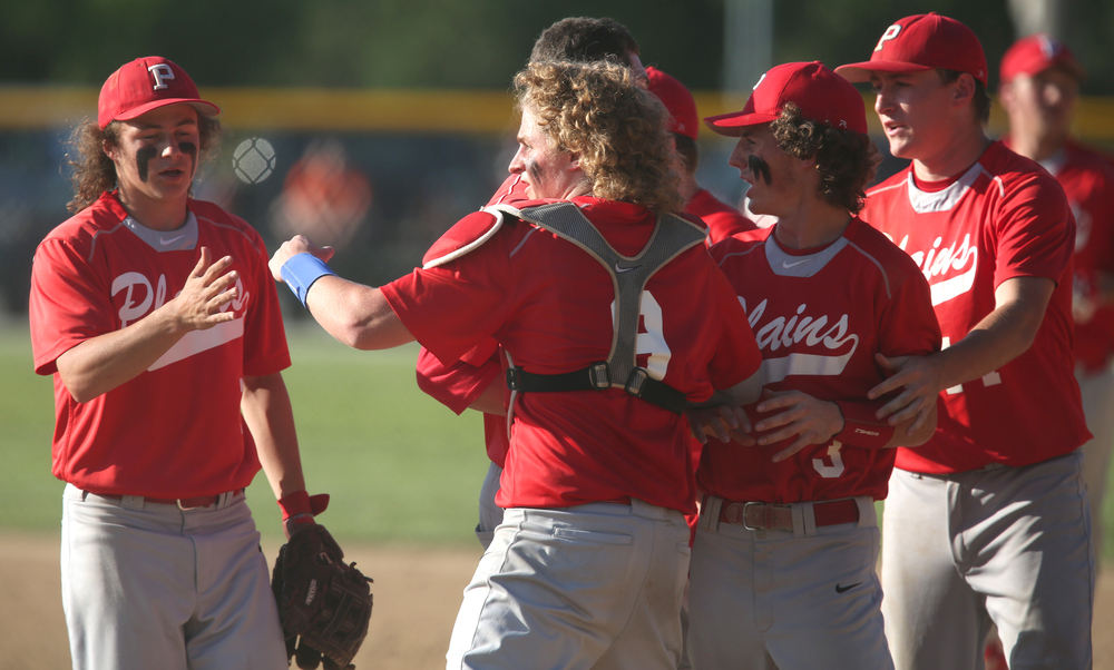 Cardinals players Daulton Nibbe at left and catcher Johnny Steinwart prepare to congratulate each other along with the rest of their teammates after defeating the Tigers at Ed Lewis Field.David Spencer/The State Journal-Register