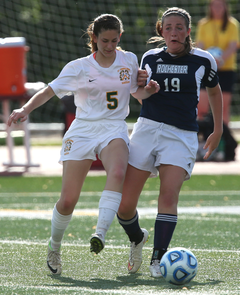 Rochester player Maddie Capps at right and Sabers player Hayes Murray try to get control of the ball during first half action. The Rochester High School Rockets defeated the Champaign St. Thomas More Sabers 3-0 during the state 1A semifinal girls soccer match at North Central College in Naperville on Friday evening, May 29, 2015. David Spencer/The State Journal-Register