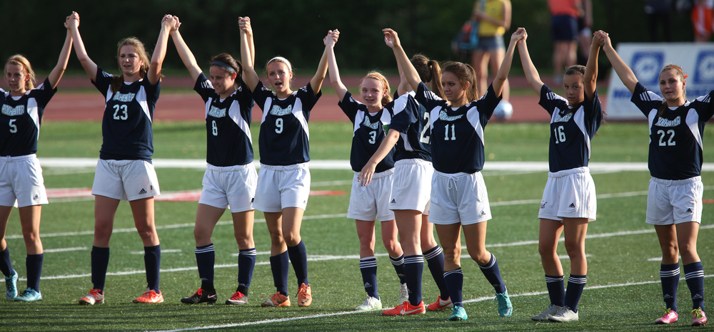 Rochester players clasp hands and acknowledge the crowd at the end of the game. The Rochester High School Rockets defeated the Champaign St. Thomas More Sabers 3-0 during the state 1A semifinal girls soccer match at North Central College in Naperville on Friday evening, May 29, 2015. David Spencer/The State Journal-Register