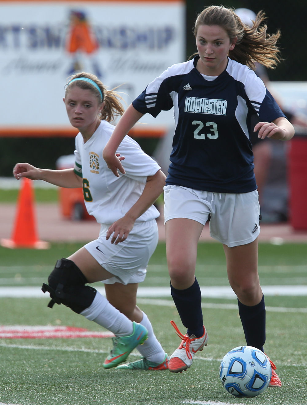 Rochester player Emma Hughes gets the ball past Sabers player Michaela Ward. The Rochester High School Rockets defeated the Champaign St. Thomas More Sabers 3-0 during the state 1A semifinal girls soccer match at North Central College in Naperville on Friday evening, May 29, 2015. David Spencer/The State Journal-Register
