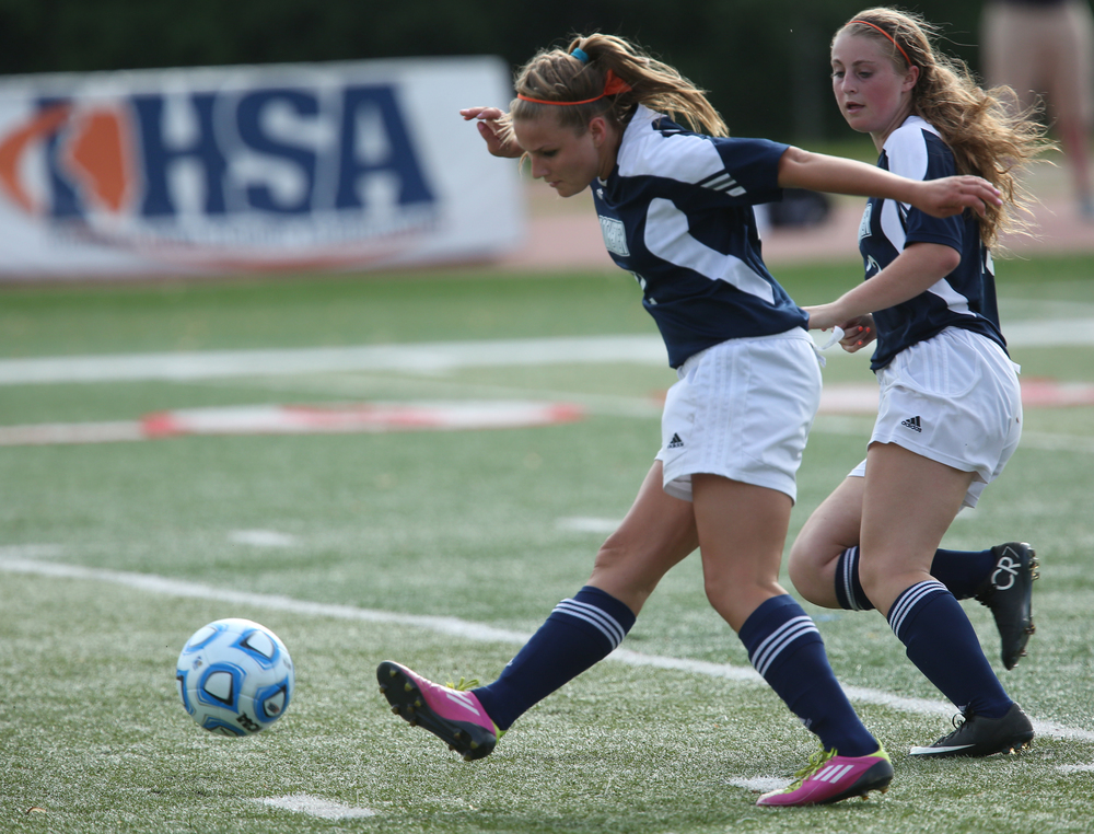 Rockets player Mandy Yeck keeps the ball going downfield during first half action. The Rochester High School Rockets defeated the Champaign St. Thomas More Sabers 3-0 during the state 1A semifinal girls soccer match at North Central College in Naperville on Friday evening, May 29, 2015. David Spencer/The State Journal-Register
