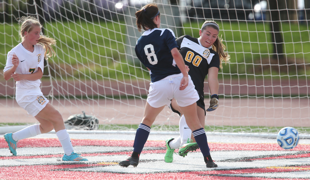 A Rockets attempt on goal by Amanda Williams went a bit wide. Sabers goalkeeper Abby Horn defends. The Rochester High School Rockets defeated the Champaign St. Thomas More Sabers 3-0 during the state 1A semifinal girls soccer match at North Central College in Naperville on Friday evening, May 29, 2015. David Spencer/The State Journal-Register