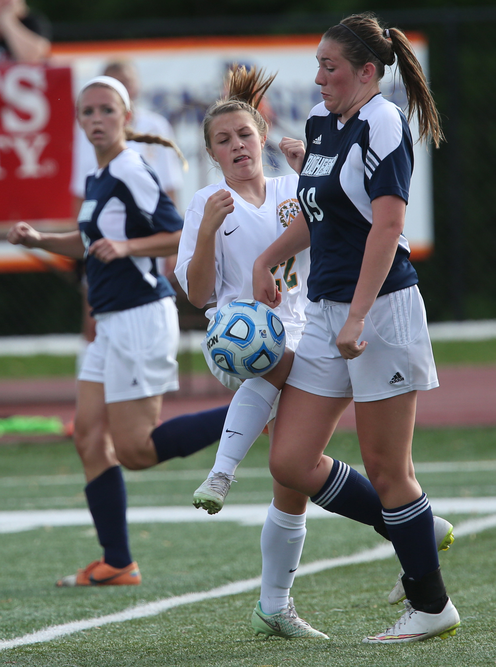 Rockets player Maddie Capps tries to keep her hands away from the ball while brushing into Sabers player Morgan Cinnamon as they each try to gain control during second half action. The Rochester High School Rockets defeated the Champaign St. Thomas More Sabers 3-0 during the state 1A semifinal girls soccer match at North Central College in Naperville on Friday evening, May 29, 2015. David Spencer/The State Journal-Register