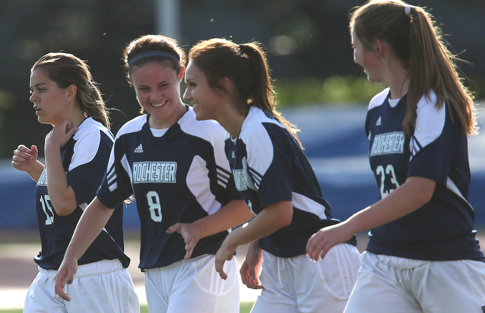 Rockets player Sydney Lett, second from right, is all smiles as her teammates congratulate her on scoring the third goal of the game. The Rochester High School Rockets defeated the Champaign St. Thomas More Sabers 3-0 during the state 1A semifinal girls soccer match at North Central College in Naperville on Friday evening, May 29, 2015. David Spencer/The State Journal-Register