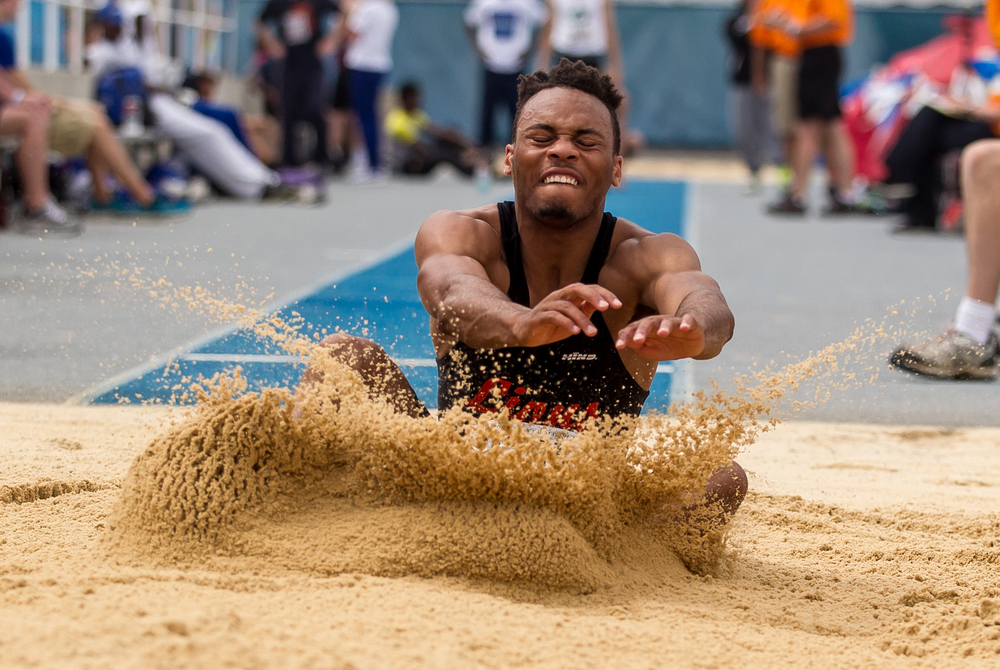 Lanphier's Daryl Jackson hits the sand in the Class 2A Long Jump during the IHSA Boys Track and Field State Finals at O'Brien Stadium, Saturday, May 30, 2015, in Charleston, Ill. Jackson finished 10th with a best jump of 21-03.50. Justin L. Fowler/The State Journal-Register