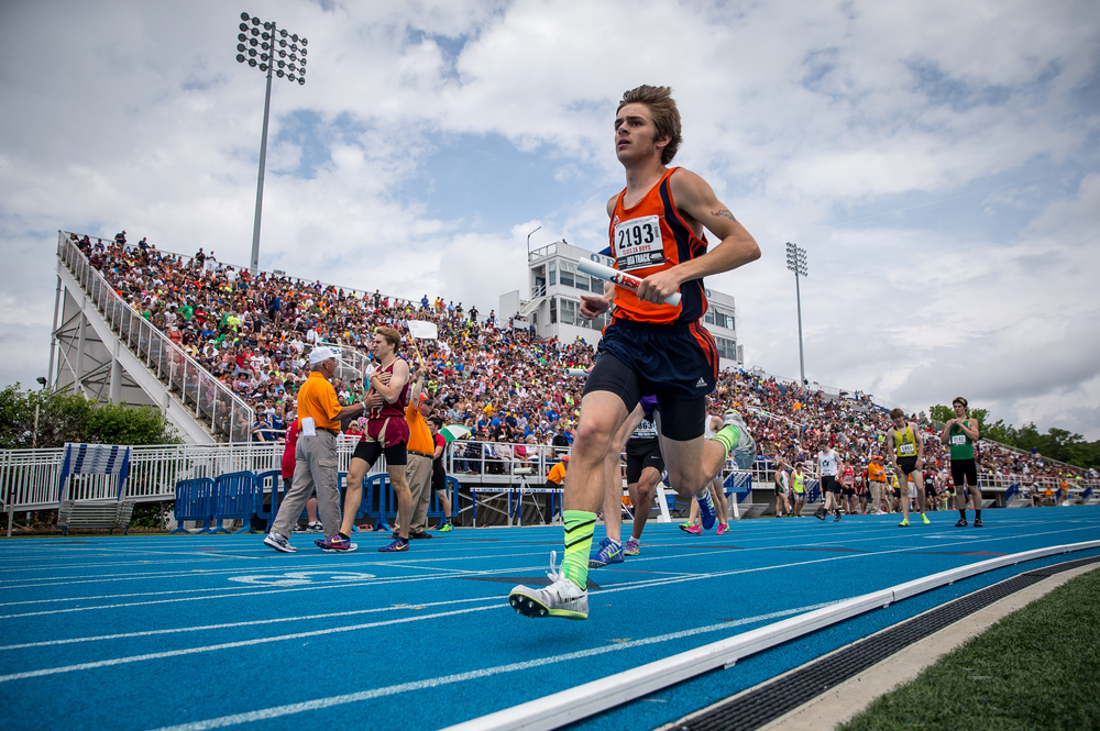 Rochester's Noah Edwards runs the second leg of the Class 2A 4x800m Relay during the IHSA Boys Track and Field State Finals at O'Brien Stadium, Saturday, May 30, 2015, in Charleston, Ill. The Rockets finished 12th with a time of 8:21.16. Justin L. Fowler/The State Journal-Register