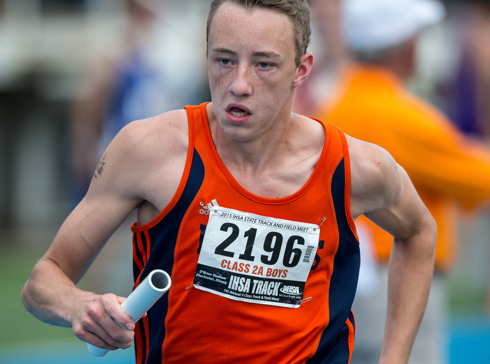 Rochester's Austin Mitchell runs the third leg of the Class 2A 4x800m Relay during the IHSA Boys Track and Field State Finals at O'Brien Stadium, Saturday, May 30, 2015, in Charleston, Ill. The Rockets finished 12th with a time of 8:21.16. Justin L. Fowler/The State Journal-Register