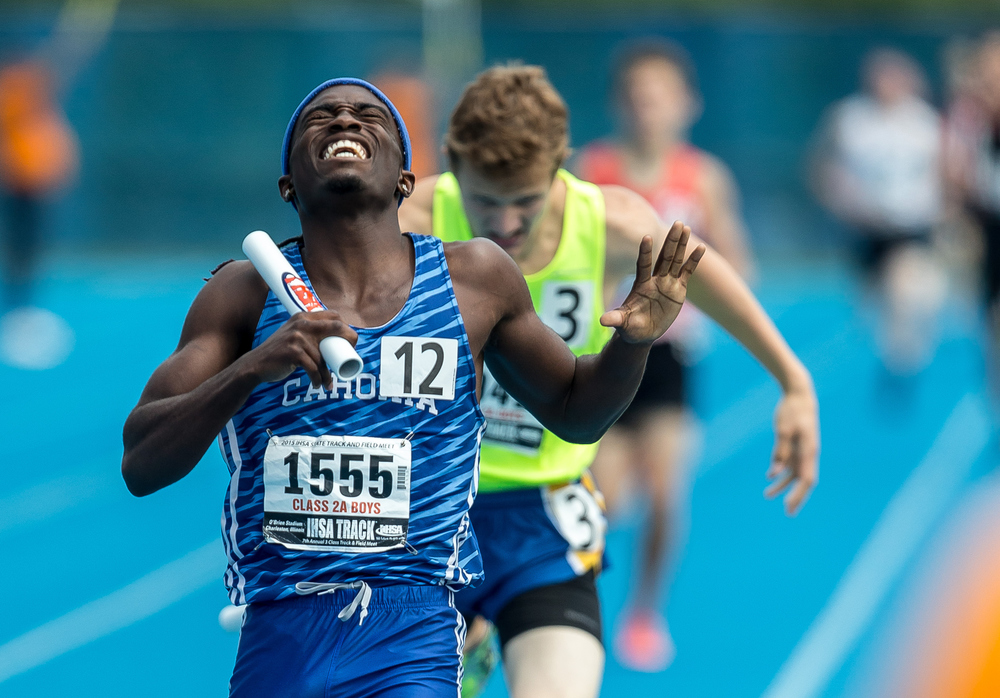 Cahokia's Tyran Lyons reacts after crossing the finish line in the final leg of the Class 2A 4x800m Relay for the victory with a time of 7:53.53 during the IHSA Boys Track and Field State Finals at O'Brien Stadium, Saturday, May 30, 2015, in Charleston, Ill. Justin L. Fowler/The State Journal-Register