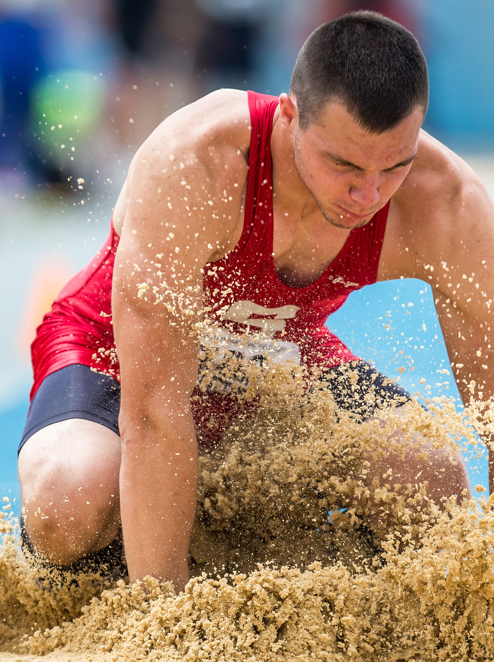 Staunton's Marcus Sitko hits the sand while competing in the Class 1A Triple Jump during the IHSA Boys Track and Field State Finals at O'Brien Stadium, Saturday, May 30, 2015, in Charleston, Ill. Sitko won the event with a best jump of 46-02.25. Justin L. Fowler/The State Journal-Register