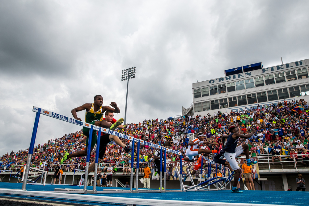 Storm clouds begin to move in during the Class 3A 110m Hurdles during the IHSA Boys Track and Field State Finals at O'Brien Stadium, Saturday, May 30, 2015, in Charleston, Ill. Justin L. Fowler/The State Journal-Register