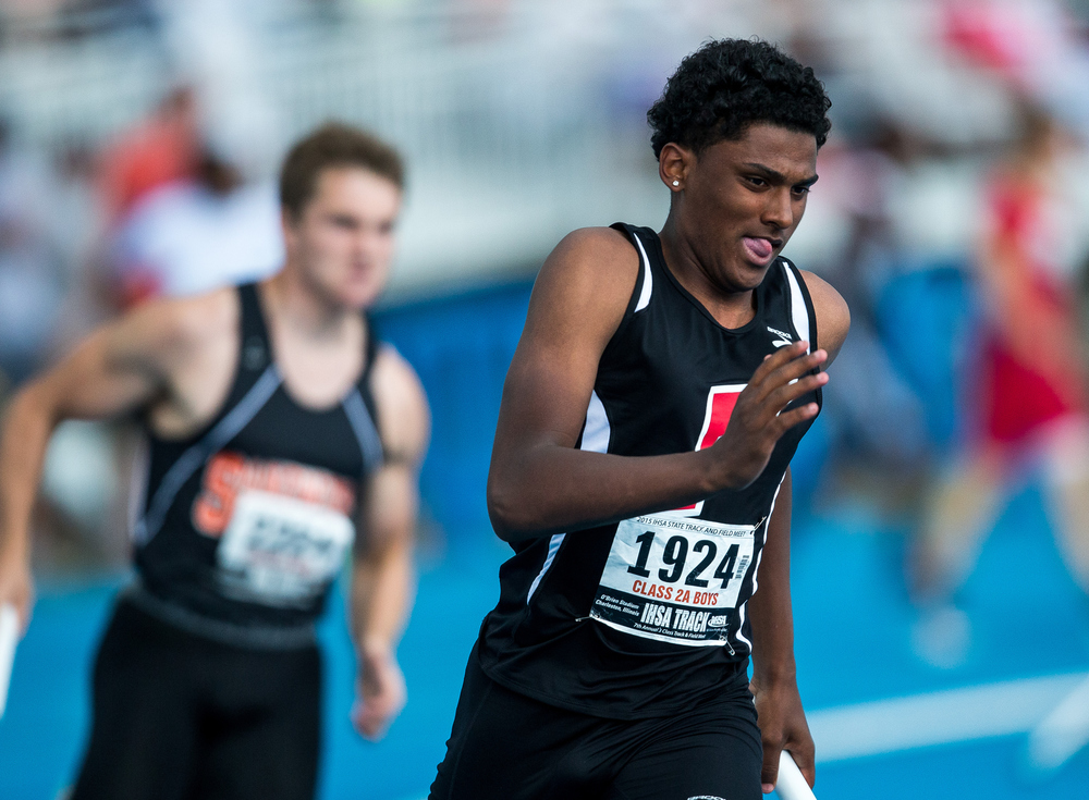 Jacksonville's James White runs the second leg of the Class 2A 4x400m Relay during the IHSA Boys Track and Field State Finals at O'Brien Stadium, Saturday, May 30, 2015, in Charleston, Ill. Jacksonville finished 7th with a time of 3:23.15. Justin L. Fowler/The State Journal-Register