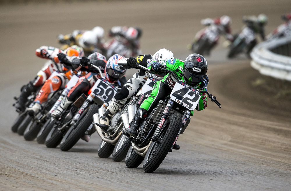 Bryan Smith adjusts the tear-offs on his helmet as he leads the pack coming out of turn #4 during the AMA Pro Flat Track Grand National Championship Springfield Mile at the Illinois State Fairgrounds, Sunday, May 24, 2015, in Springfield, Ill. Smith won the race leading 24 of the 25 laps. Justin L. Fowler/The State Journal-Register