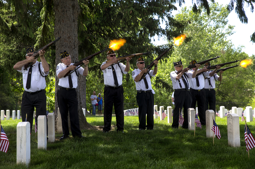 The Inter-Veterans Burial Detail of Sangamon County fires one of three rifle volleys during the annual Memorial Day ceremony at Camp Butler National Cemetery Monday, May 25, 2015. Ted Schurter/The State Journal-Register