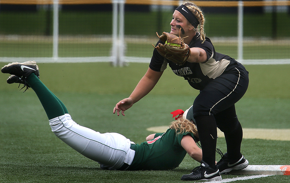 Cyclones first baseman Ashton Dyche fields the ball as Railers baserunner Lauren Block slides back safely during third inning action. David Spencer/The State Journal-Register