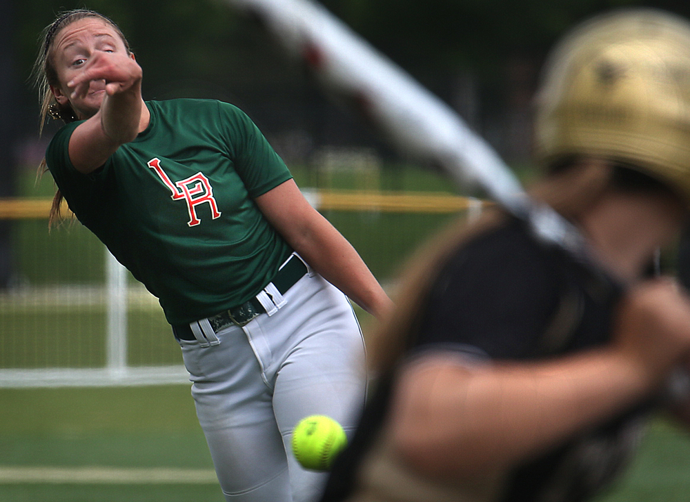 Losing Railers pitcher Holly Davis shows her form against an SHG batter during an early inning Monday afternoon. David Spencer/The State Journal-Register