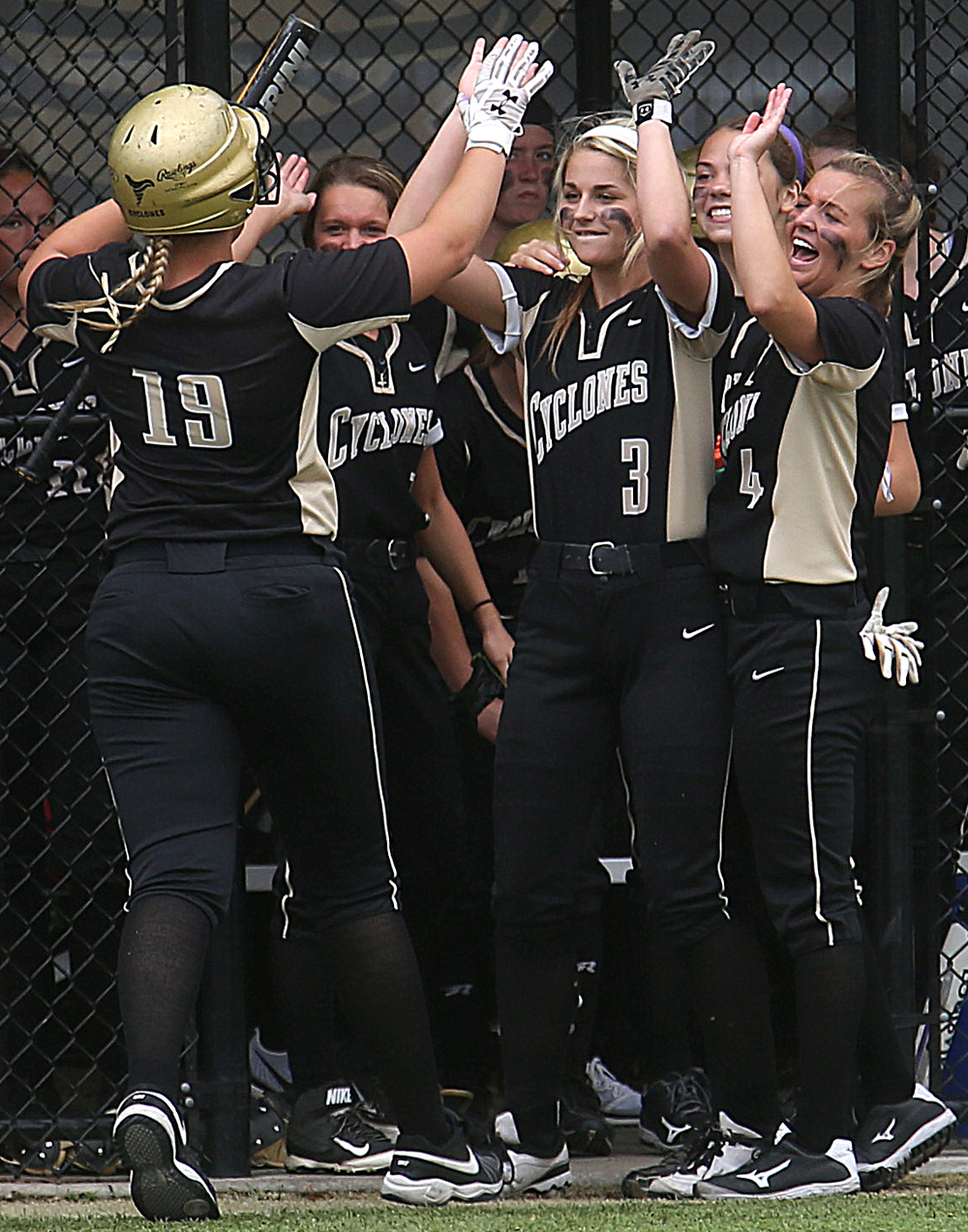 SHG baserunner Ashton Dyche is welcomed home to the dugout by teammates after she scored her team's second run of the game Monday. David Spencer/The State Journal-Register
