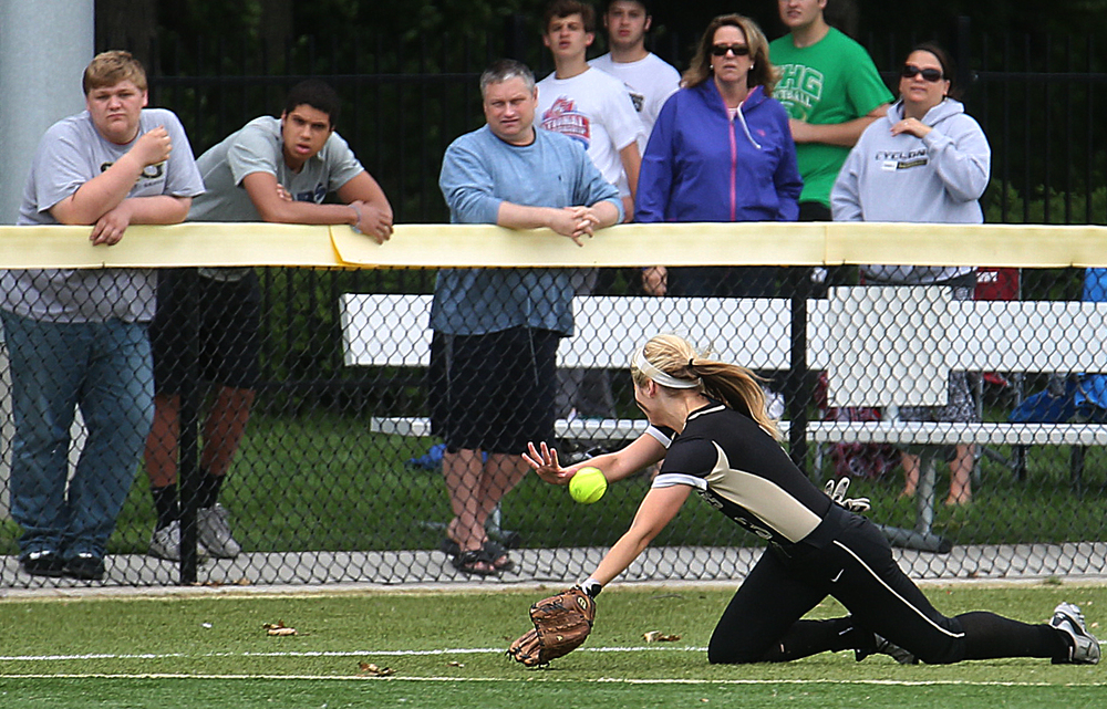 SHG outfielder Makenzie Trees came up a bit short while trying to field a ball hit by Railers batter Holly Davis in the seventh inning that dropped for a single. David Spencer/The State Journal-Register