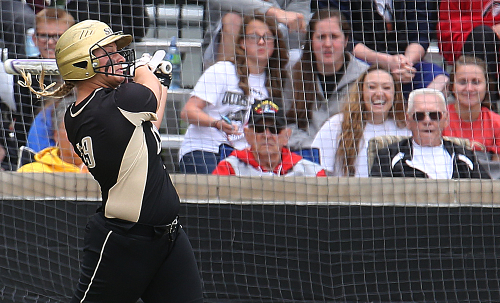 In eighth inning action, SHG batter Ashton Dyche hit the ball far enough into the outfield to pick up the game winning rbi as Bree Derhake scored. David Spencer/The State Journal-Register