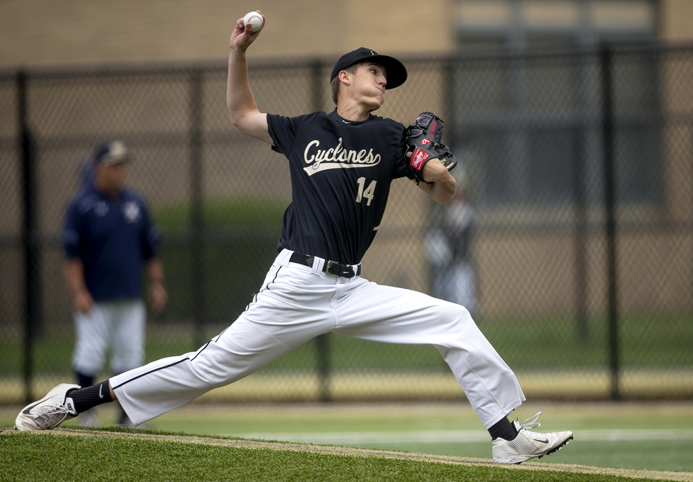 Sacred Heart-Griffin's Jakck Staten delivers a pitch to Quincy Notre Dame during the Class 3A SHG Regional final Monday, June 1, 2015. Ted Schurter/The State Journal-Register