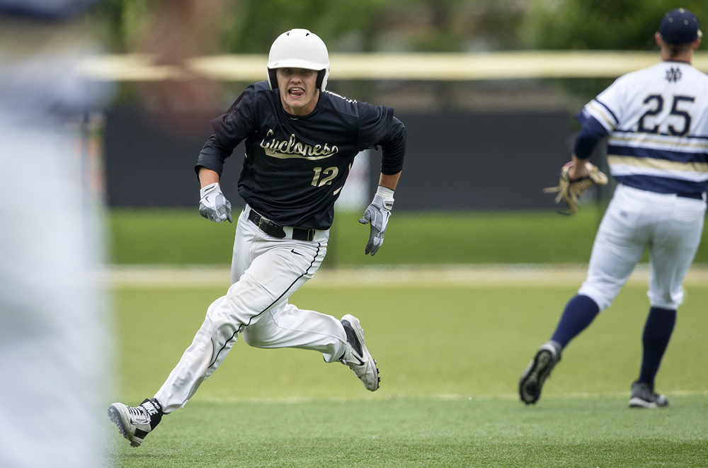 Sacred Heart-Griffin's Sean Mason sprints around second base on his way to scoring against Quincy Notre Dame during the Class 3A SHG Regional final Monday, June 1, 2015. Ted Schurter/The State Journal-Register