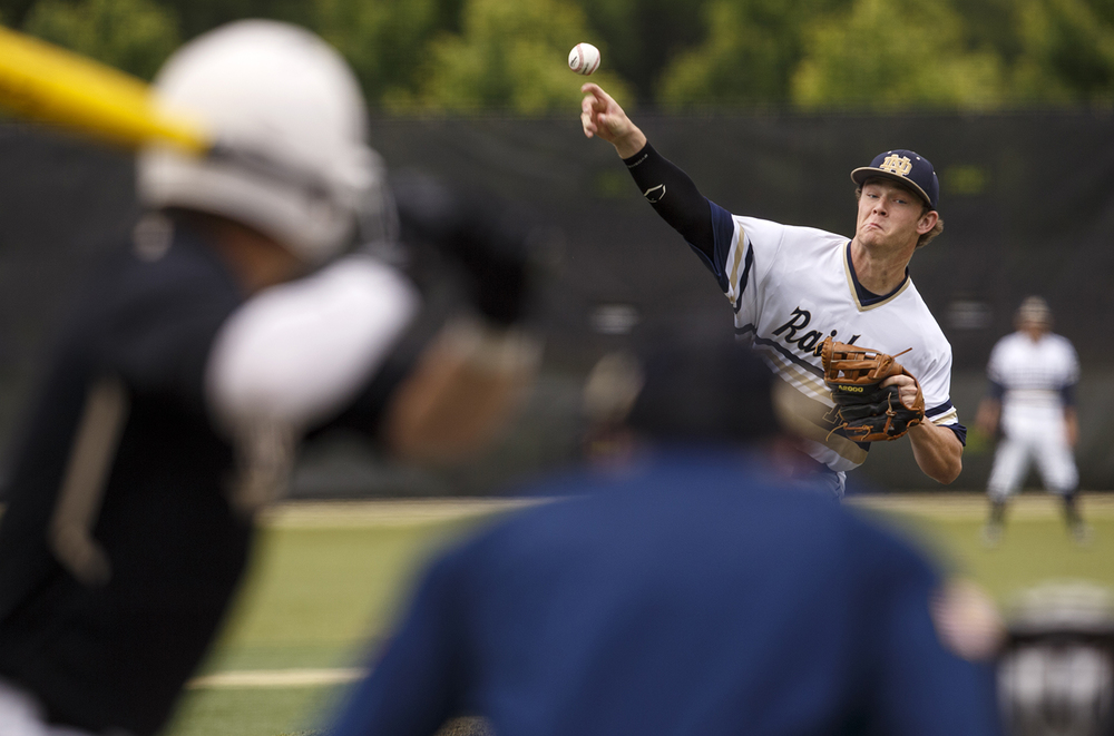 Quincy Notre Dame's Justin Tallman delivers a pitch to Sacred Heart-Griffin during the Class 3A SHG Regional final Monday, June 1, 2015. Ted Schurter/The State Journal-Register