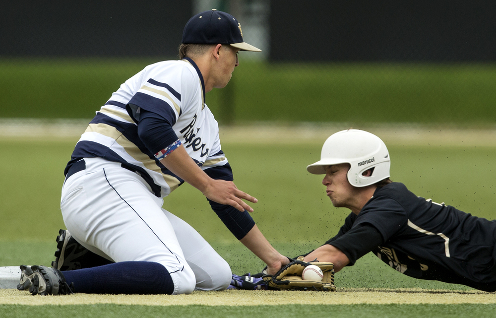 Quincy Notre Dame's Joey Polak tags out Sacred Heart-Griffin's Cole Daily during the Class 3A SHG Regional final Monday, June 1, 2015. Ted Schurter/The State Journal-Register