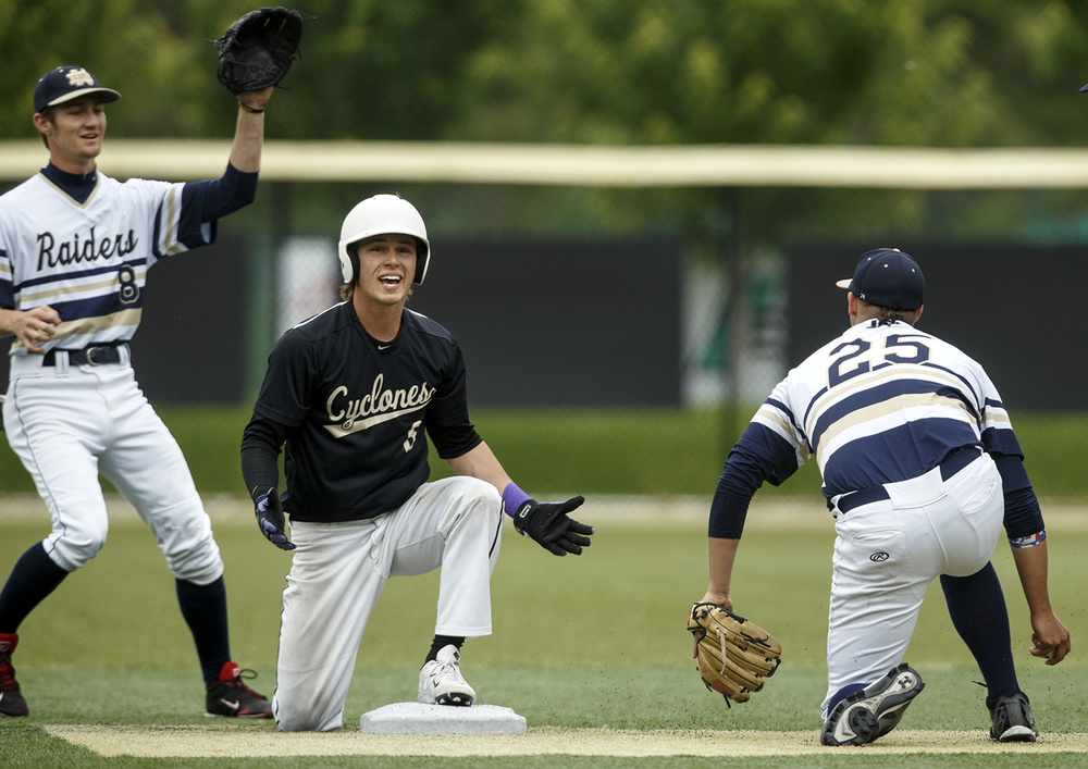 Sacred Heart-Griffin's Cole Daily is surpised by the call after being tagged out at second base during the Class 3A SHG Regional final Monday, June 1, 2015. Ted Schurter/The State Journal-Register