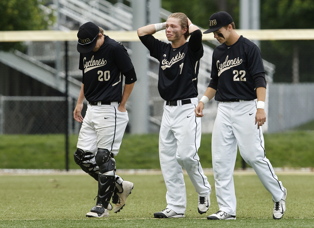 Sacred Heart-Griffin's Mason Hale, left, Clayton Taylor and Devin Thomas walk off the field after losing to Quincy Notre Dame during the Class 3A SHG Regional final Monday, June 1, 2015. Ted Schurter/The State Journal-Register