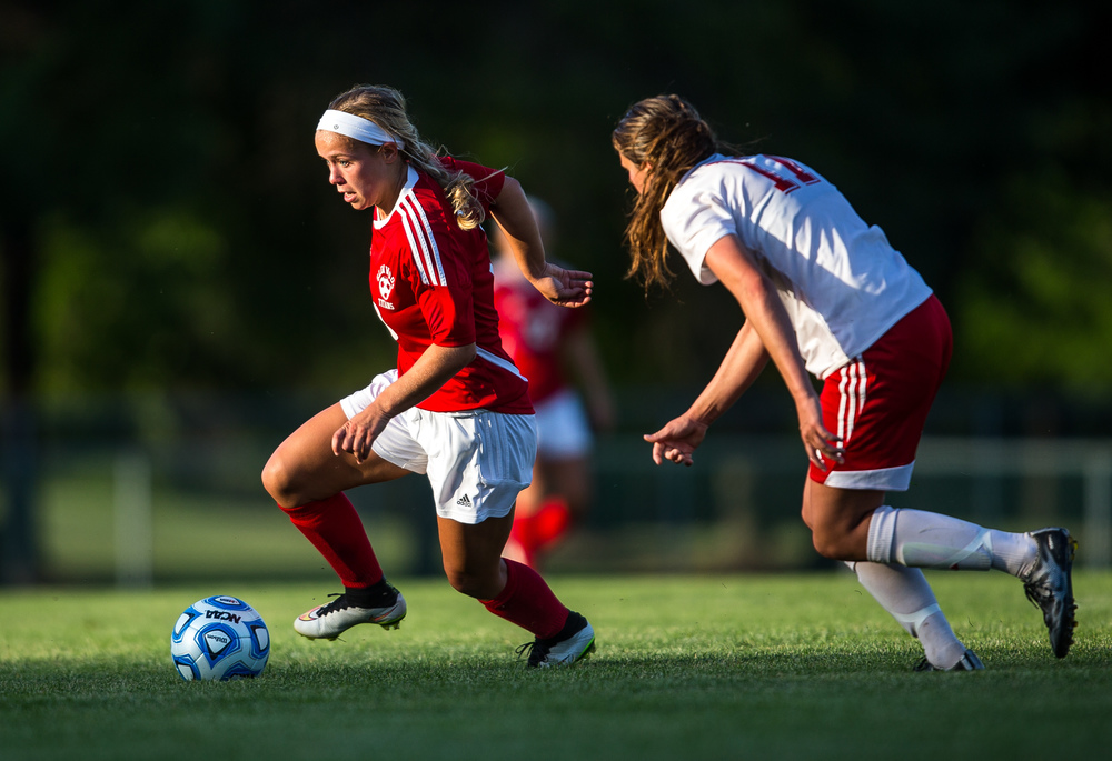 Glenwood's Kelly Graves (10) accelerates past Metamora's Peyton Roehnelt (17) as she tries to move the ball down the field during the Class 2A Springfield Supersectional at Kiwanis Stadium, Tuesday, June 2, 2015, in Springfield, Ill. Justin L. Fowler/The State Journal-Register