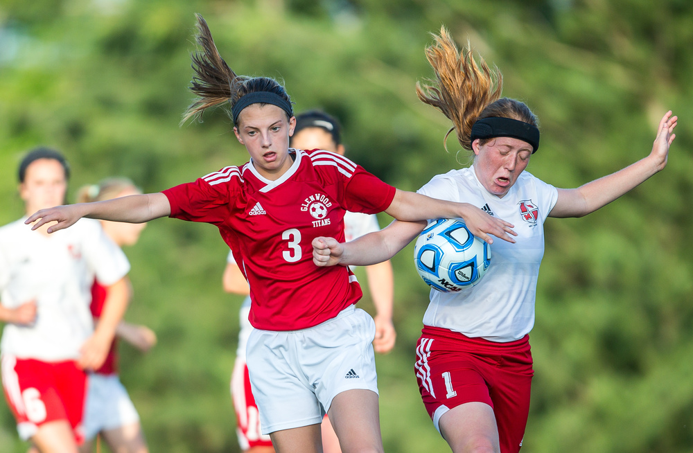 Glenwood's Katie Juhlin (3) and Metamora's Quinn Matthews (1) get tangled up going for possession of the ball in the second half during the Class 2A Springfield Supersectional at Kiwanis Stadium, Tuesday, June 2, 2015, in Springfield, Ill. Justin L. Fowler/The State Journal-Register