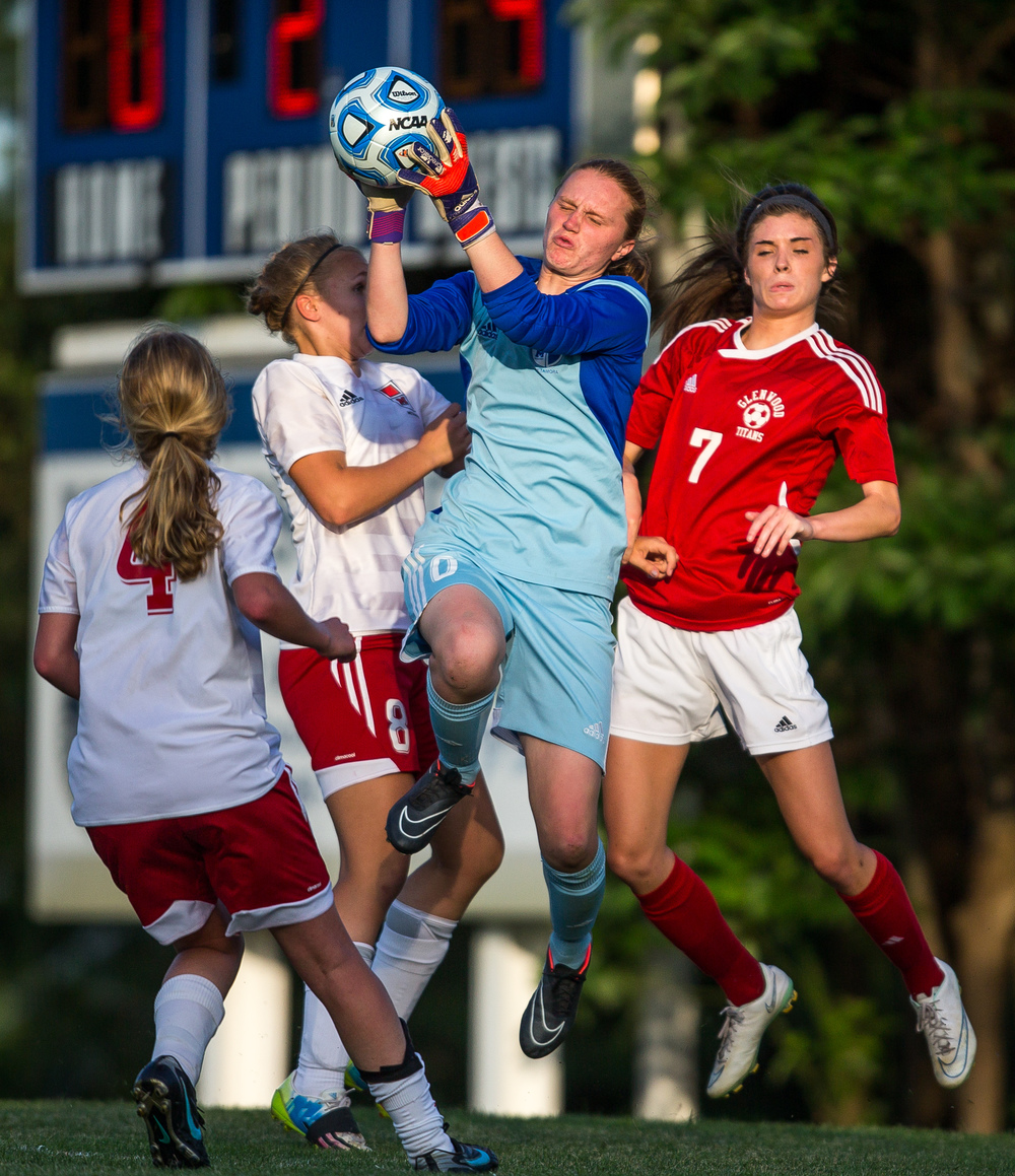 Metamora goal keeper Kate Keller makes a save in front of Glenwood's Maddie Klintworth (7) in the second half during the Class 2A Springfield Supersectional at Kiwanis Stadium, Tuesday, June 2, 2015, in Springfield, Ill. Justin L. Fowler/The State Journal-Register