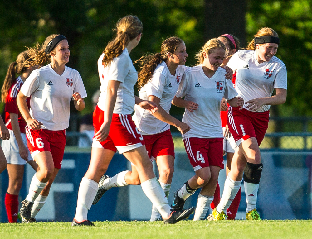 Metamora's Rebecca Wipfler (4) celebrates with her teammates after scoring a goal against Glenwood to make it 4-1 Titans in the second half during the Class 2A Springfield Supersectional at Kiwanis Stadium, Tuesday, June 2, 2015, in Springfield, Ill. Justin L. Fowler/The State Journal-Register