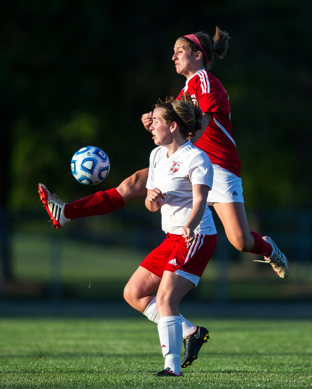 Glenwood's Blaire Marker (20) tries to win a ball out of the air against Metamora's Brittany Johnson (5) in the second half during the Class 2A Springfield Supersectional at Kiwanis Stadium, Tuesday, June 2, 2015, in Springfield, Ill. Justin L. Fowler/The State Journal-Register