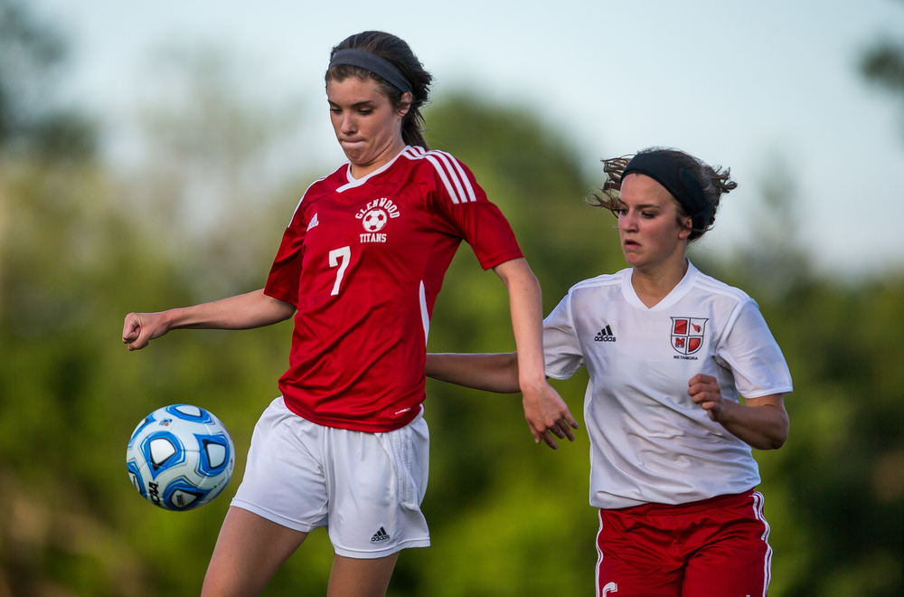 Glenwood's Maddie Klintworth (7) wins a ball in front of Metamora's Sydney Billimack (6) in the second half during the Class 2A Springfield Supersectional at Kiwanis Stadium, Tuesday, June 2, 2015, in Springfield, Ill. Justin L. Fowler/The State Journal-Register