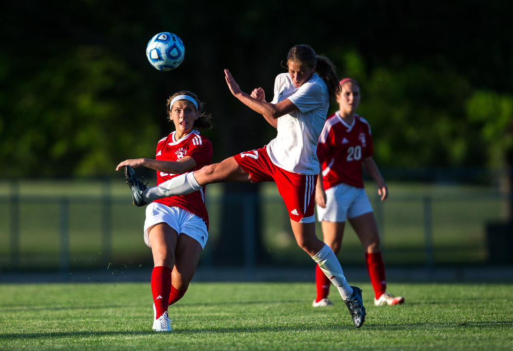 Glenwood's Maggie Juhlin (22) clears a ball out against Metamora's Peyton Roehnelt (17) in the second half during the Class 2A Springfield Supersectional at Kiwanis Stadium, Tuesday, June 2, 2015, in Springfield, Ill. Justin L. Fowler/The State Journal-Register