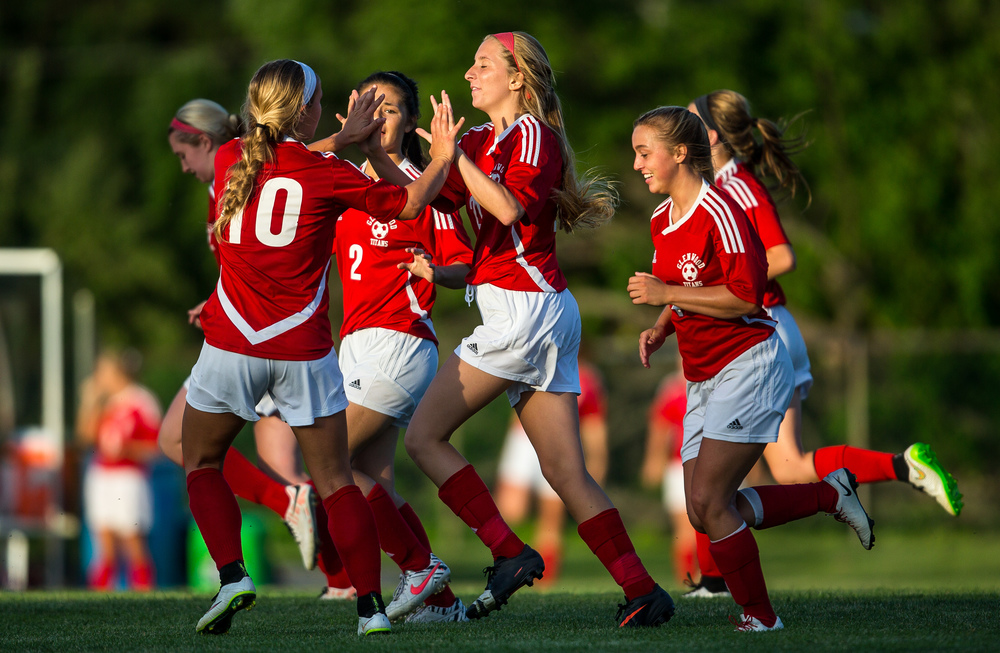 Glenwood's Kennedy Sheedy (21) gets a high from Kelly Graves (10) after scoring a goal in the second half against Metamora during the Class 2A Springfield Supersectional at Kiwanis Stadium, Tuesday, June 2, 2015, in Springfield, Ill. Justin L. Fowler/The State Journal-Register