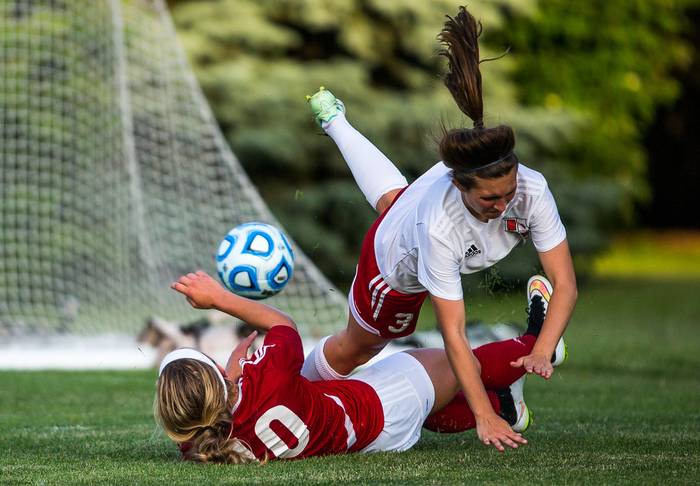 Glenwood's Kelly Graves (10) collides with Metamora's Heather De Luca (3) going for a shot on goal in the second half during the Class 2A Springfield Supersectional at Kiwanis Stadium, Tuesday, June 2, 2015, in Springfield, Ill. Justin L. Fowler/The State Journal-Register