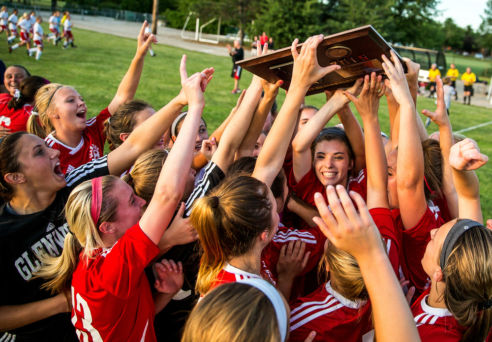 The Titans celebrate with the Class 2A Springfield Supersectional trophy after defeating Metamora 5-1 at Kiwanis Stadium, Tuesday, June 2, 2015, in Springfield, Ill. Justin L. Fowler/The State Journal-Register