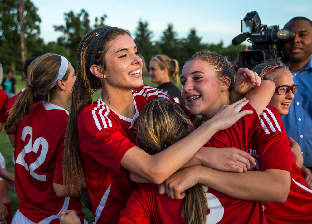 Glenwood's Maddie Klintworth, left, celebrates with Katie Juhlin, front, and Rachel Mays, right, after the Titans defeated Metamora 5-1 to win the Class 2A Springfield Supersectional at Kiwanis Stadium, Tuesday, June 2, 2015, in Springfield, Ill. Justin L. Fowler/The State Journal-Register