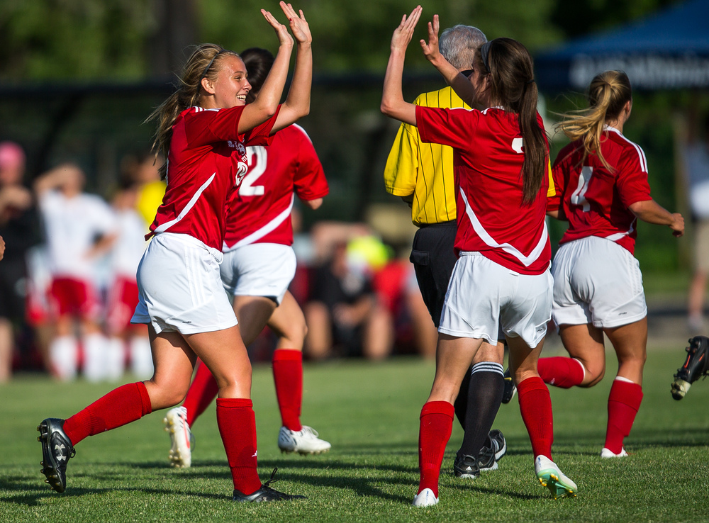 Glenwood's Madison Volpert (19) high fives Maddie Klintworth (7) after scoring a goal against Metamora in the first half during the Class 2A Springfield Supersectional at Kiwanis Stadium, Tuesday, June 2, 2015, in Springfield, Ill. Justin L. Fowler/The State Journal-Register