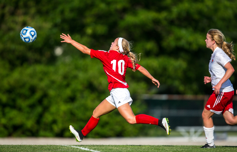 An opportunity for a shot on goal goes just out of reach of Glenwood's Kelly Graves (10) against Metamora in the first half during the Class 2A Springfield Supersectional at Kiwanis Stadium, Tuesday, June 2, 2015, in Springfield, Ill. Justin L. Fowler/The State Journal-Register