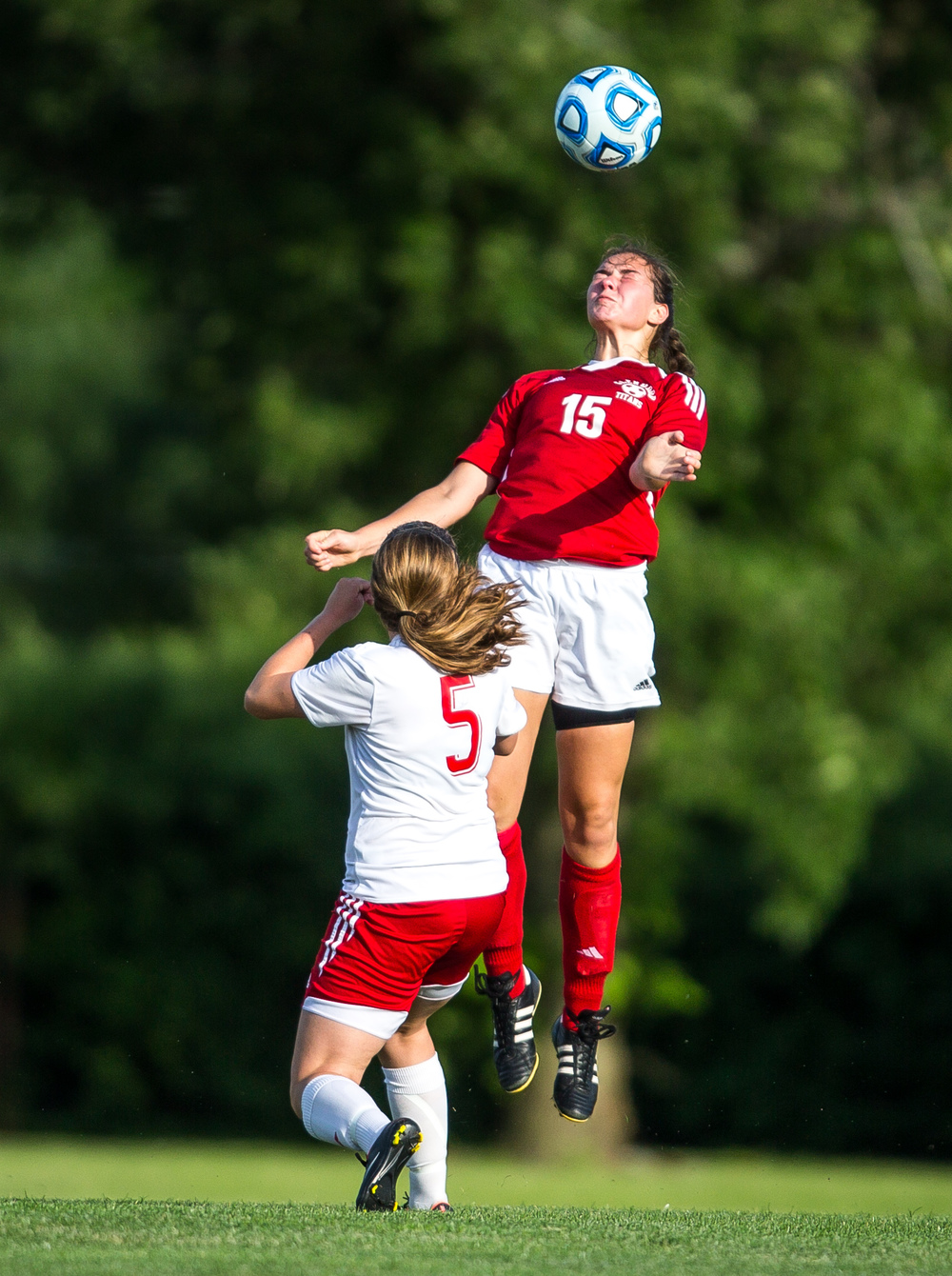Glenwood's Alie Smith (15) wins a header against Metamora's Brittany Johnson (5) in the first half during the Class 2A Springfield Supersectional at Kiwanis Stadium, Tuesday, June 2, 2015, in Springfield, Ill. Justin L. Fowler/The State Journal-Register