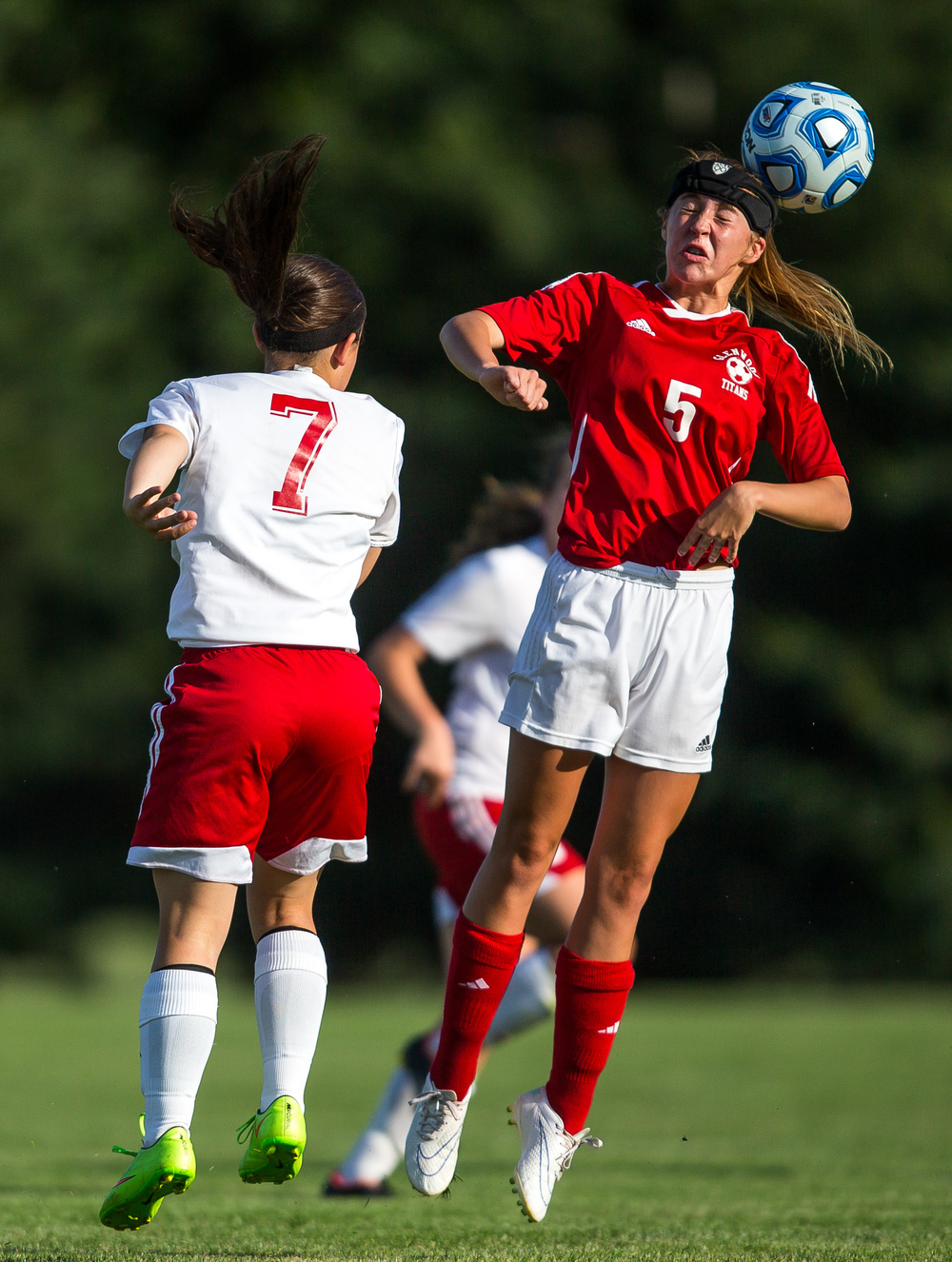 Glenwood's Rachel Mays (5) smacks a header against Metamora's Mamie Ambrosch (7) in the first half during the Class 2A Springfield Supersectional at Kiwanis Stadium, Tuesday, June 2, 2015, in Springfield, Ill. Justin L. Fowler/The State Journal-Register