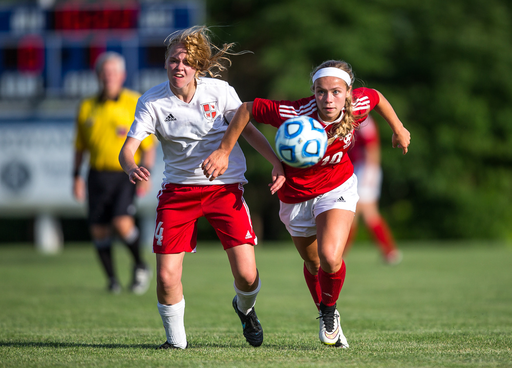 Glenwood's Kelly Graves (10) eyes a ball against Metamora's Rebecca Wipfler (4) in the first half during the Class 2A Springfield Supersectional at Kiwanis Stadium, Tuesday, June 2, 2015, in Springfield, Ill. Justin L. Fowler/The State Journal-Register