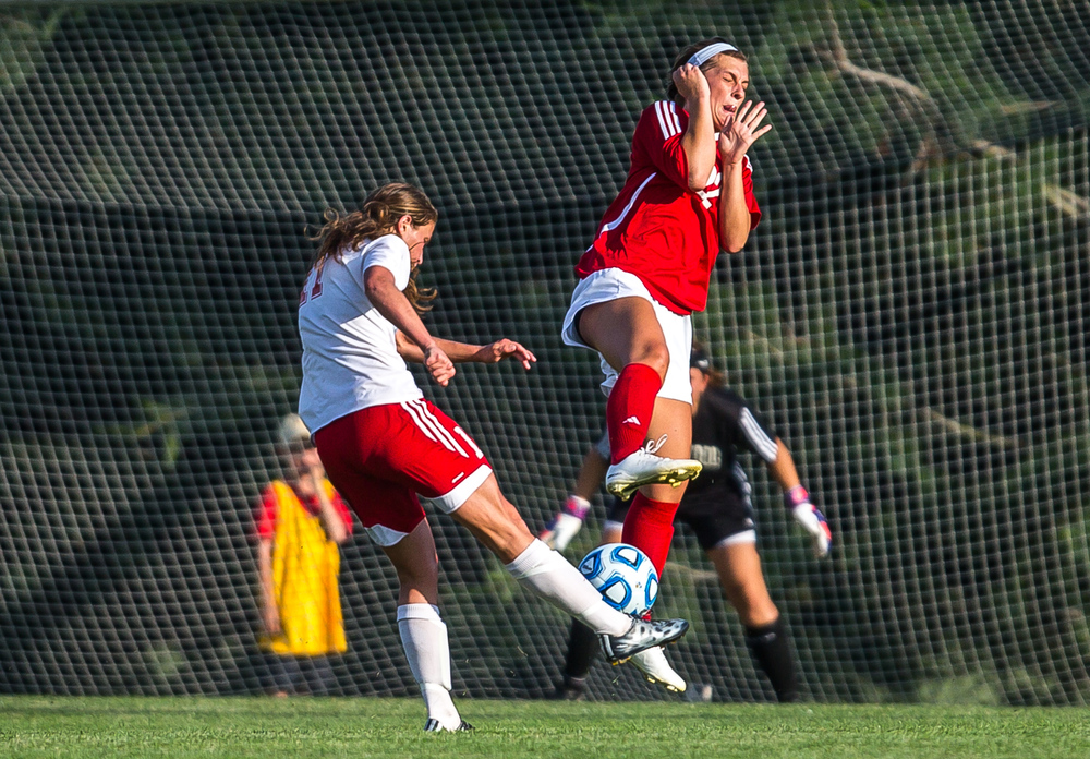 Glenwood's Maggie Juhlin (22) tries to block a shot from Metamora's Peyton Roehnelt (17) in the first half during the Class 2A Springfield Supersectional at Kiwanis Stadium, Tuesday, June 2, 2015, in Springfield, Ill. Justin L. Fowler/The State Journal-Register