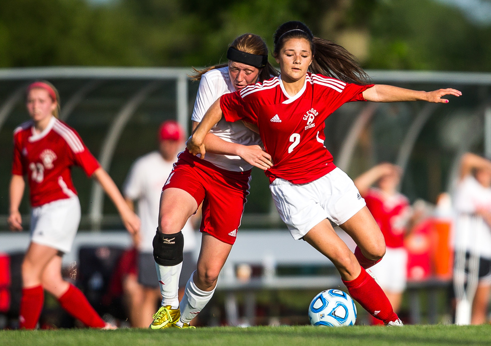 Glenwood's Taylor Parriott (2) works the ball around Metamora's Quinn Matthews (1) during the Class 2A Springfield Supersectional at Kiwanis Stadium, Tuesday, June 2, 2015, in Springfield, Ill. Justin L. Fowler/The State Journal-Register