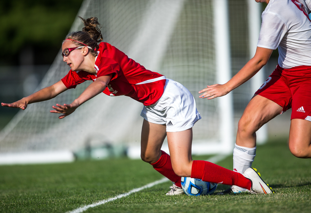 Glenwood's Samantha Kessinger (9) is knocked to the ground by Metamora's Alison Lee (8) resulting in a  penalty kick for Glenwood in the first half during the Class 2A Springfield Supersectional at Kiwanis Stadium, Tuesday, June 2, 2015, in Springfield, Ill. Justin L. Fowler/The State Journal-Register
