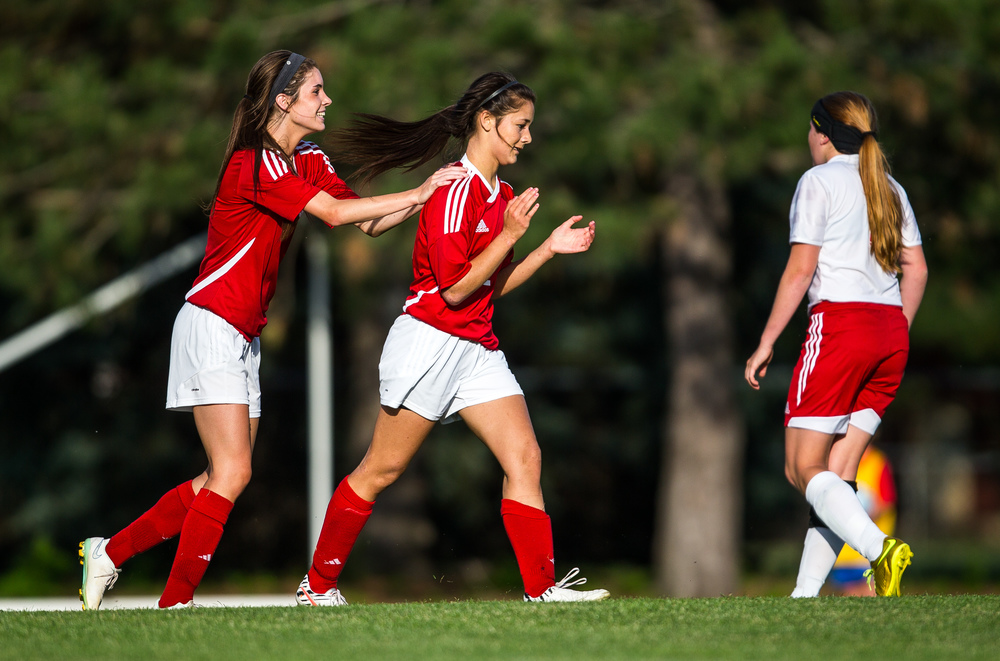 Glenwood's Maddie Klintworth (7) congratulates Taylor Parriott (2) after she scored a goal against Metamora in the first half during the Class 2A Springfield Supersectional at Kiwanis Stadium, Tuesday, June 2, 2015, in Springfield, Ill. Justin L. Fowler/The State Journal-Register